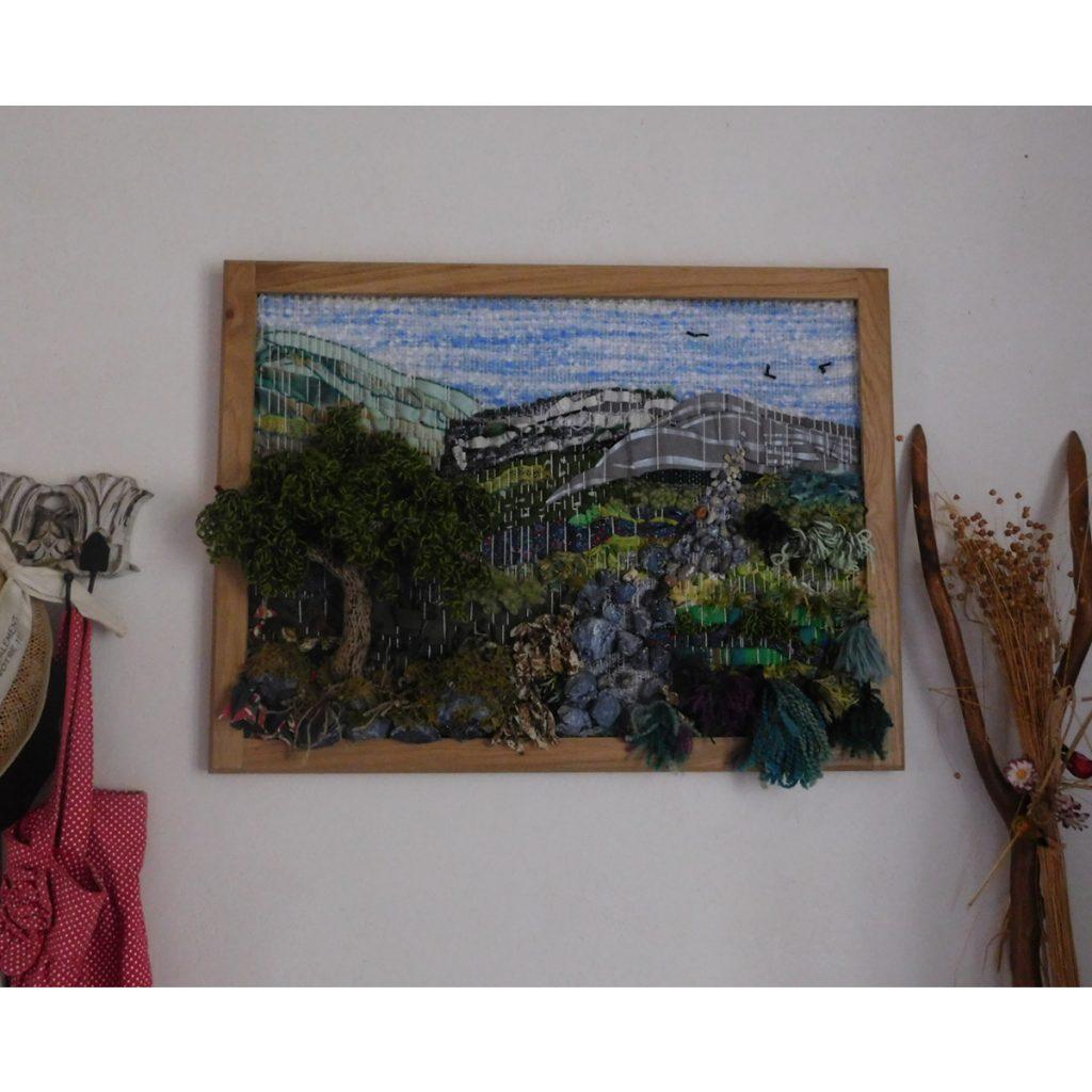 Le tableau tissage en 3d est magnifique sur un mur blanc. Il prend bien sûr tout son relief.